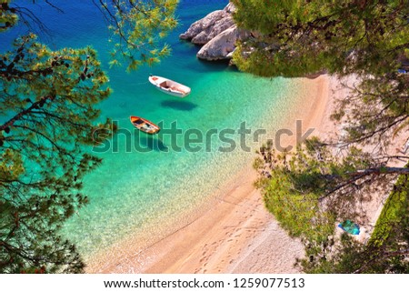 Hiden beach in Brela with boats on emerald sea aerial view, Makarska riviera of Dalmatia, Croatia #1259077513