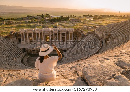 Hierapolis ancient city Pamukkale Turkey, young woman with hat watching sunset by the ruins Unesco  #1167278953