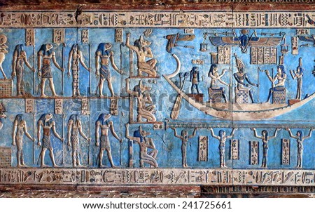 Hieroglyphic carvings and paintings on the interior walls of an ancient egyptian temple in Dendera