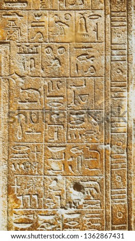 Hieroglyphics on rock surface during Rameses dynasty.