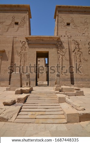 Hieroglyphs engraved on one of the entrance doors of the temple of Isis.Temple of Philae. Aswan Egypt