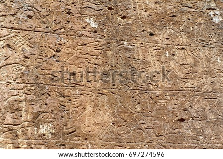 Hieroglyphs from the 8th century inscribed on a flat stone in Nevsehir province, Turkey #697274596
