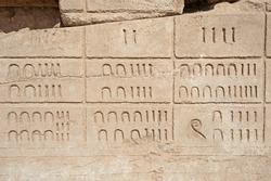 Hieroglypic numerical carvings on wall at the ancient egyptian temple of Karnak in Luxor