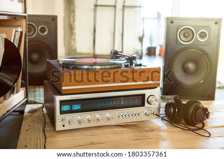 HiFi system with turntable, amplifier, headphones and lp vinyl records in a listening room