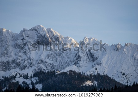 High alpine ridge covered in snow #1019279989