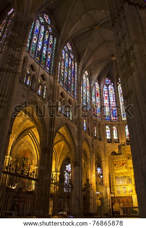 high altar and stained glass windows in the cathedral of Leon, Spain