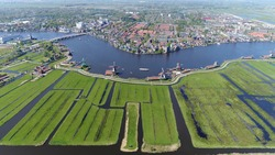 High altitude aerial view of Zaanse Schans is a neighbourhood of Zaandam near Amsterdam the Netherlands and is best known for its collection of well-preserved historic windmills and houses