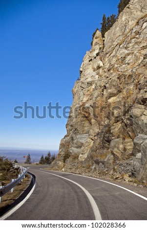 high altitude asphalt road with curve in mountain area