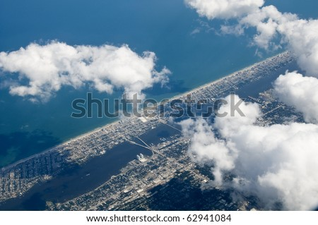High altitude photo of inter-coastal city and ocean