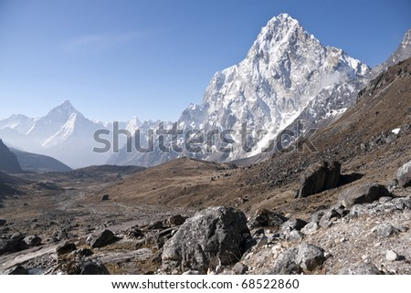 High altitude valley in the Himalaya Mountains of Nepal. Most prominent mountain Arakam Tse - 6423m.