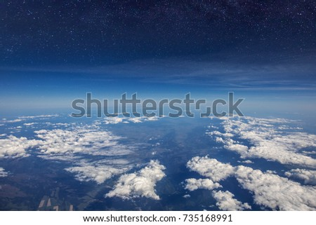 High altitude view between sky and space , in to the dark. Sky view plane.
