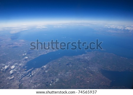 High altitude view of coastline. Belfast, in Northern Ireland is at the river mouth. - stock photo