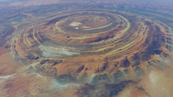 High altitude view of the Richat Structure is a prominent circular feature in the Sahara's Adrar Plateau near Ouadane west central Mauritania in Northwest Africa 4k screenshot of animation