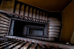 High angle aerial above view down of old vintage staircase winding spiral in Lviv, Ukraine, Europe with nobody architecture dark low-key abstract pattern
