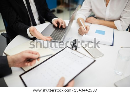 High angle closeup of unrecognizable business people discussing deal during meeting, copy space #1343442539