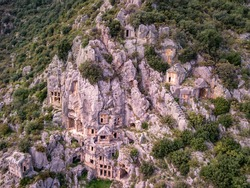 High angle drone aerial view of ancient greek rock cut lykian empire amphitheatre and tombs in Myra (Demre, Turkey)