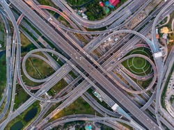 High angle looking top down view of complicate road and expressway intersection in Bangkok city of Thailand. Shot by drone can use for transportation or abstract concept.