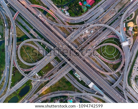 High angle looking top down view of complicate road and expressway intersection in Bangkok city of Thailand. Shot by drone can use for transportation or abstract concept. ストックフォト ©