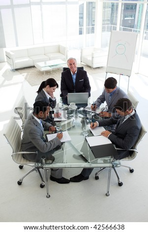 High angle of a business people showing diversity in a meeting