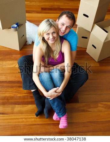High angle of a couple sitting on floor together. Moving house