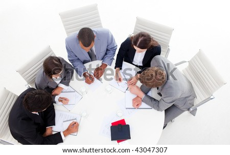 High angle of a diverse business group sitting around a conference table in a meeting