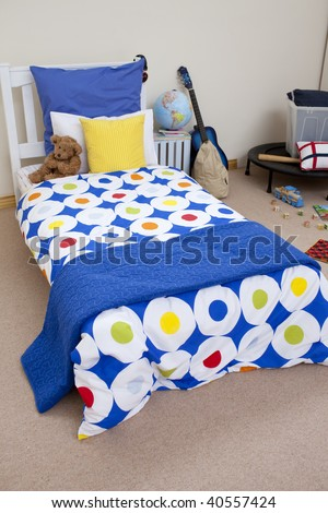 High angle of colorful kid's bedroom with toys and a guitar - stock photo