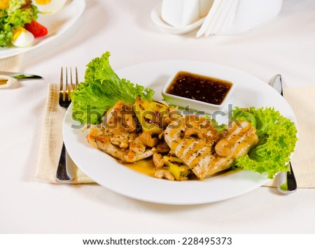 High Angle of Pineapple Cashew Chicken Dish on Plate in Restaurant