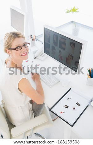 High angle portrait of a female photo editor working on computer in a bright office