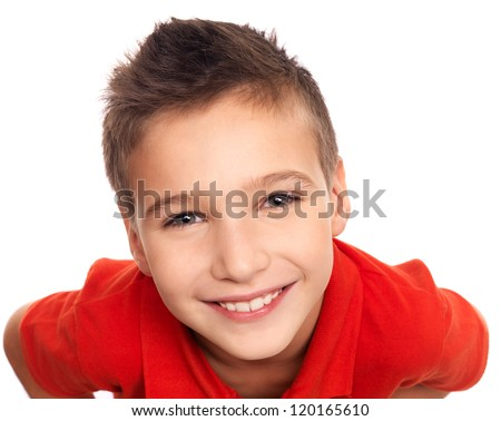 High angle portrait of adorable young happy boy looking at camera