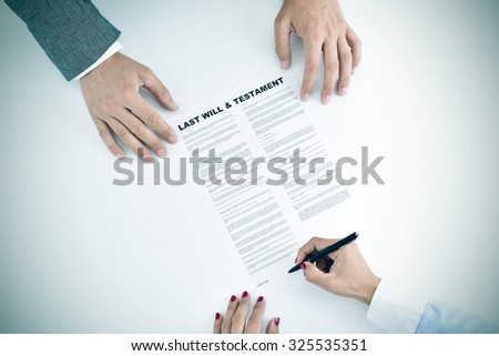 high-angle shot of a young woman signing a last will and testament document in front of a young man Stock photo ©