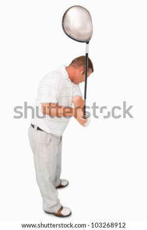 High angle shot of golfer against a white background