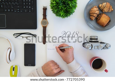 High angle shot of items on a table at an office workstation #772705390