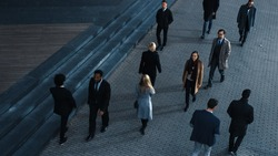 High Angle Shot of Office Managers and Business People Commuting to Work in the Morning or from Office in the Evening on Foot. Pedestrians are Dressed Smartly. Successful People Holding Smartphones.