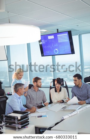 High angle vierw of business partners discussing in meeting at office desk #680333011