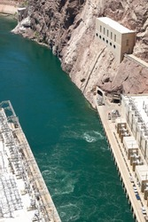 High Angle View Looking Down at Green Churning Water of Colorado River and Hydroelectric Equipment at Hoover Dam on Border of Arizona and Nevada, USA