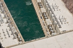 High Angle View Looking Down at Green Water of Colorado River and Hydroelectric Equipment from top of Hoover Dam, a Popular Tourist Attraction in Black Canyon on Border of Arizona and Nevada, USA