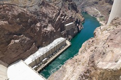 High Angle View Looking Down at Green Water of Colorado River from Hoover Dam, a Popular Tourist Attraction in Black Canyon on Border of Arizona and Nevada, USA