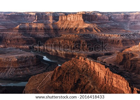 high angle view of a canyon with red rocks and a rive on a sunrise Photo stock ©