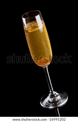 High angle view of a champagne cocktail isolated on a black background
