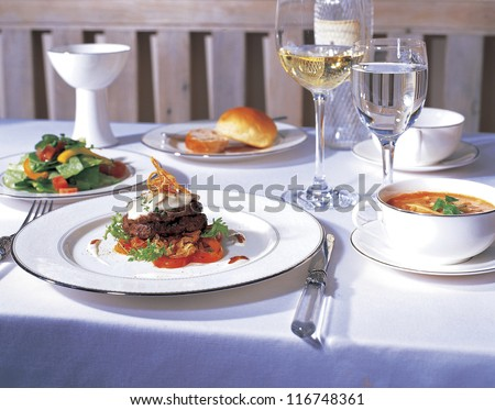 High angle view of a dining table with dishes and glasses