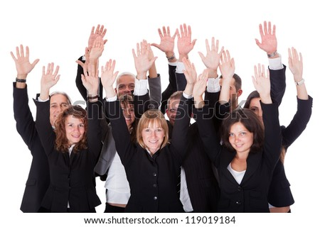 High angle view of a diverse group of business people waving in acknowledgment of an accolade isolated on white