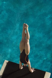 High angle view of a female diver diving into the pool