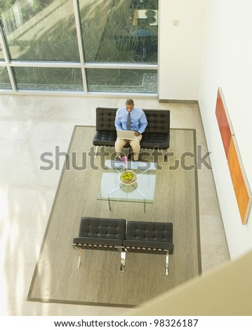High angle view of African American businessman working on laptop
