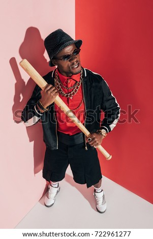 high angle view of aggressive african american man holding baseball bat #722961277