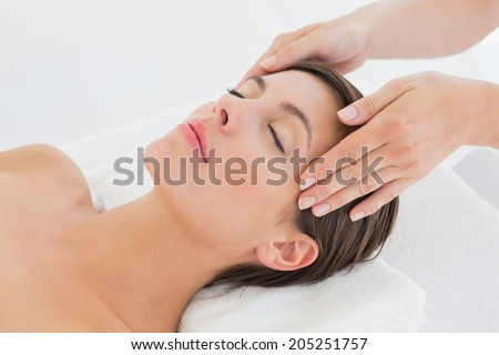 High angle view of an attractive young woman receiving head massage at spa center #205251757