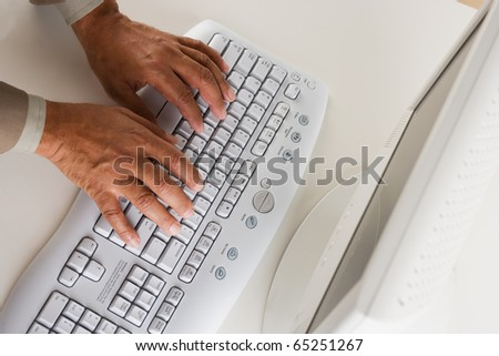 High angle view of businessman's hands on keyboard