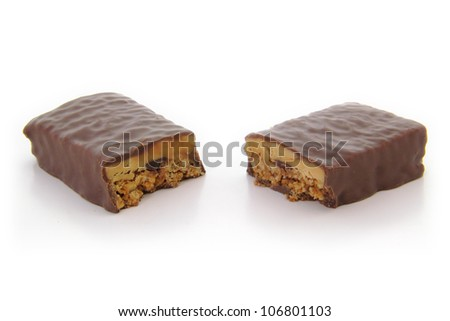 High angle view of chocolate protein bar cut in half.