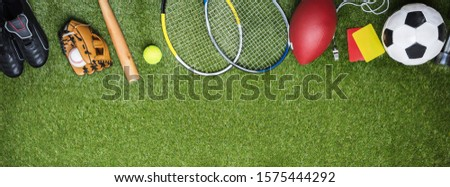 High Angle View Of Different Sports Balls And Equipment Fake Green Turf Grass Backdrop #1575444292