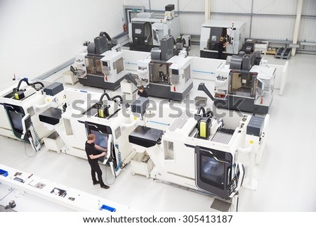 High Angle View Of Engineering Workshop With CNC Machines