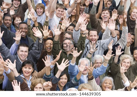 High angle view of group of happy multiethnic people raising hands together